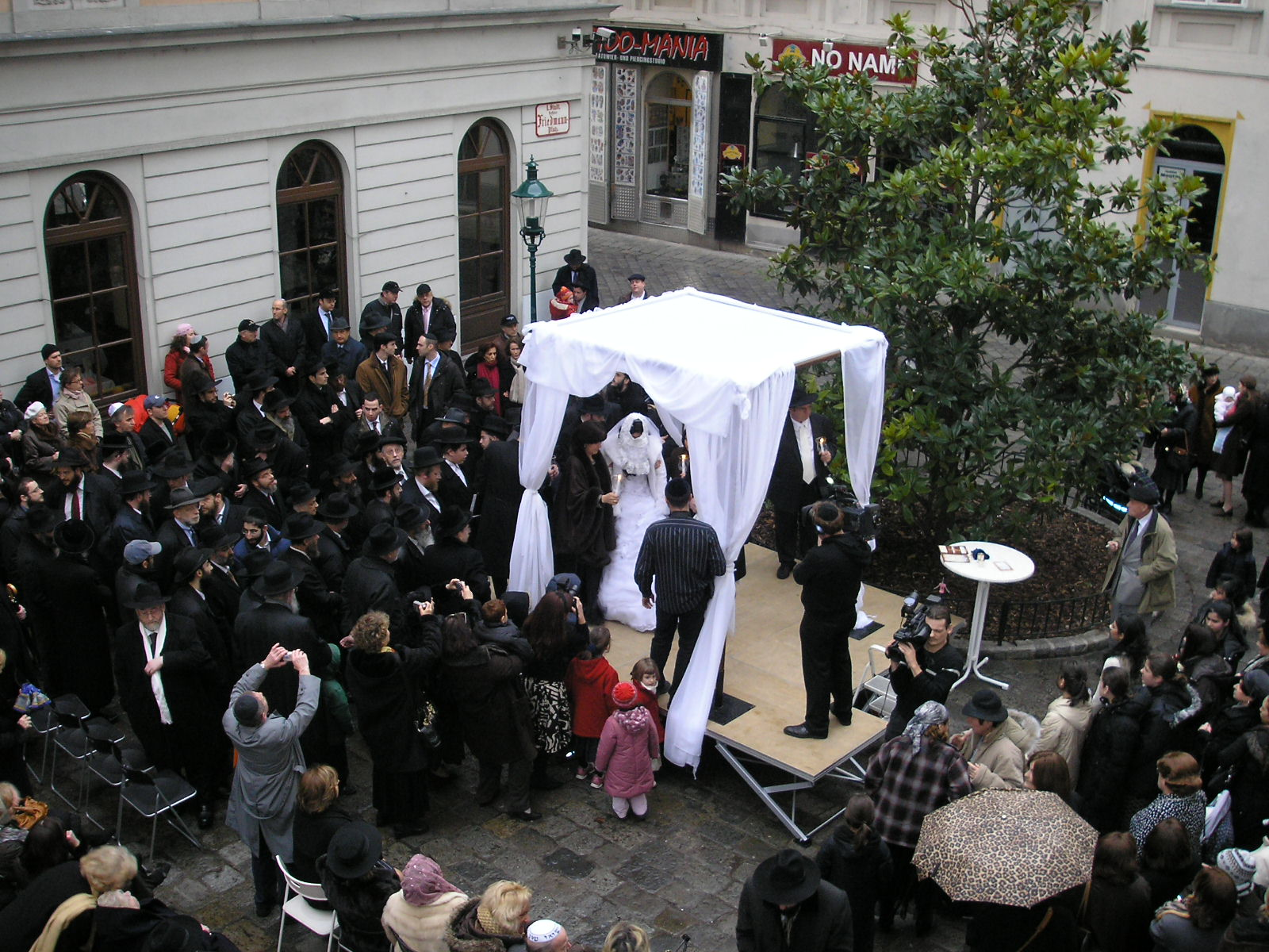An outdoor Jewish wedding under a huppah in Vienna