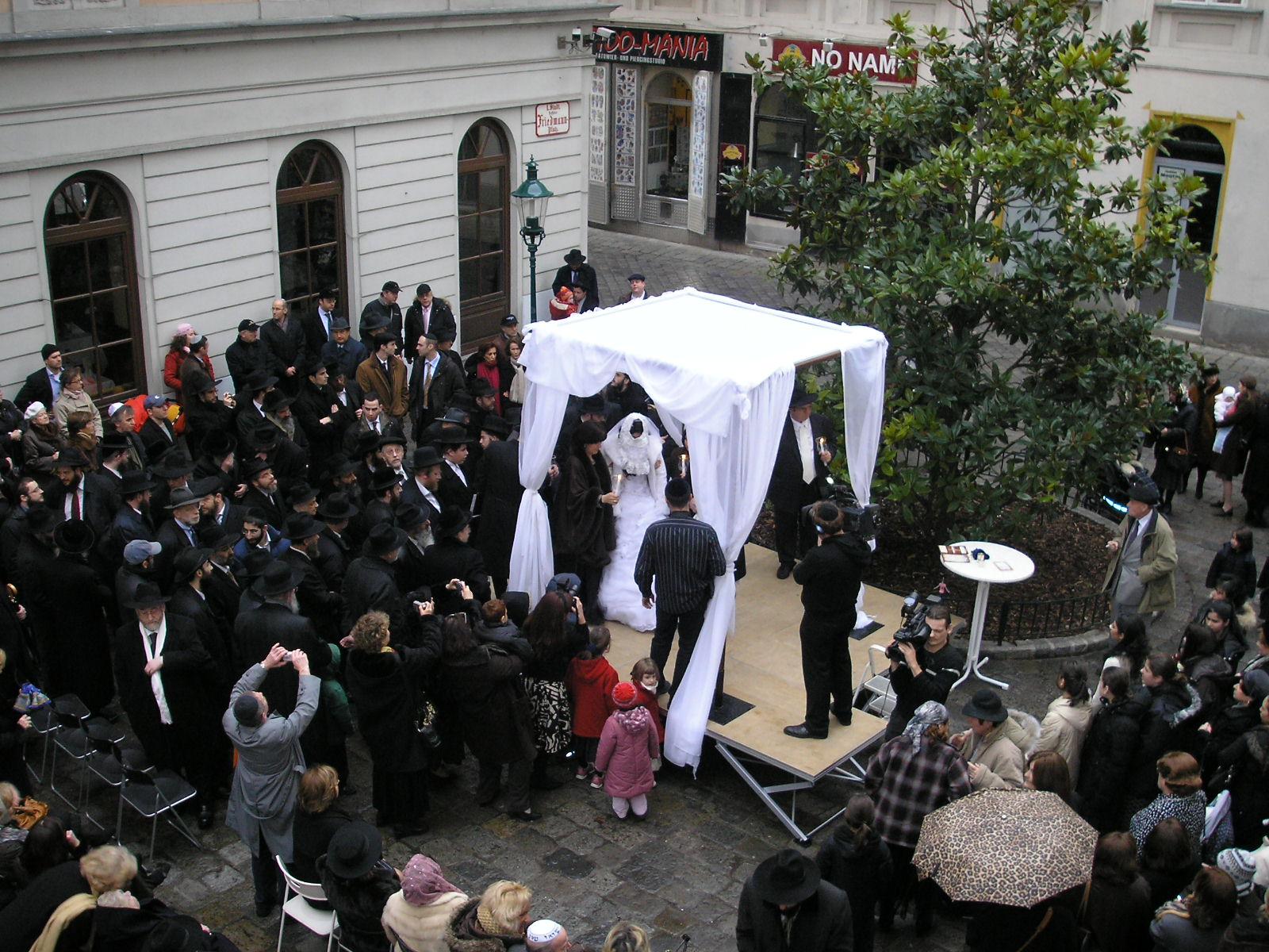 An outdoor Jewish wedding under a huppah in Vienna