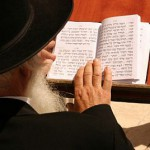 An Orthodox Jewish man reads from the siddur (prayer book) at the Western (Wailing) Wall