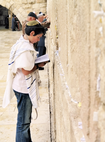 Young man-prays-Western (Wailing) Wall-Jerusalem