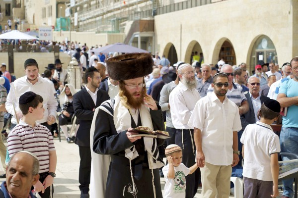 An Orthodox Jewish man prays in the men's section at the Western (Wailing) Wall Plaza in the Old City of Jerusalem.