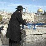 An Orthodox Jewish man looks over the Western (Wailing) Wall plaza in the Old City of Jerusalem