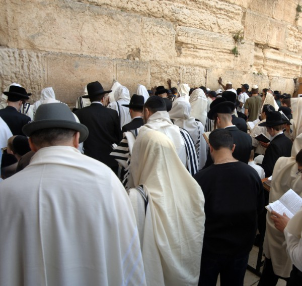 Jewish men-praying-Kotel-Western (Wailing) Wall-melakhah-Shabbat