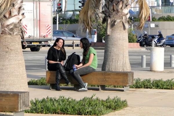 Photo-of-Tel-Aviv-Women-Sitting-Together-on-Promenade