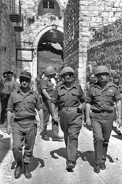 Defense Minister Moshe Dayan (center) enters the Old City of Jerusalem during the Six Day War with Commander Uzi Narkiss (left) and Chief of Staff Lt. Gen. Yitzhak Rabin (right).  (Photo by Ilan Bruner)