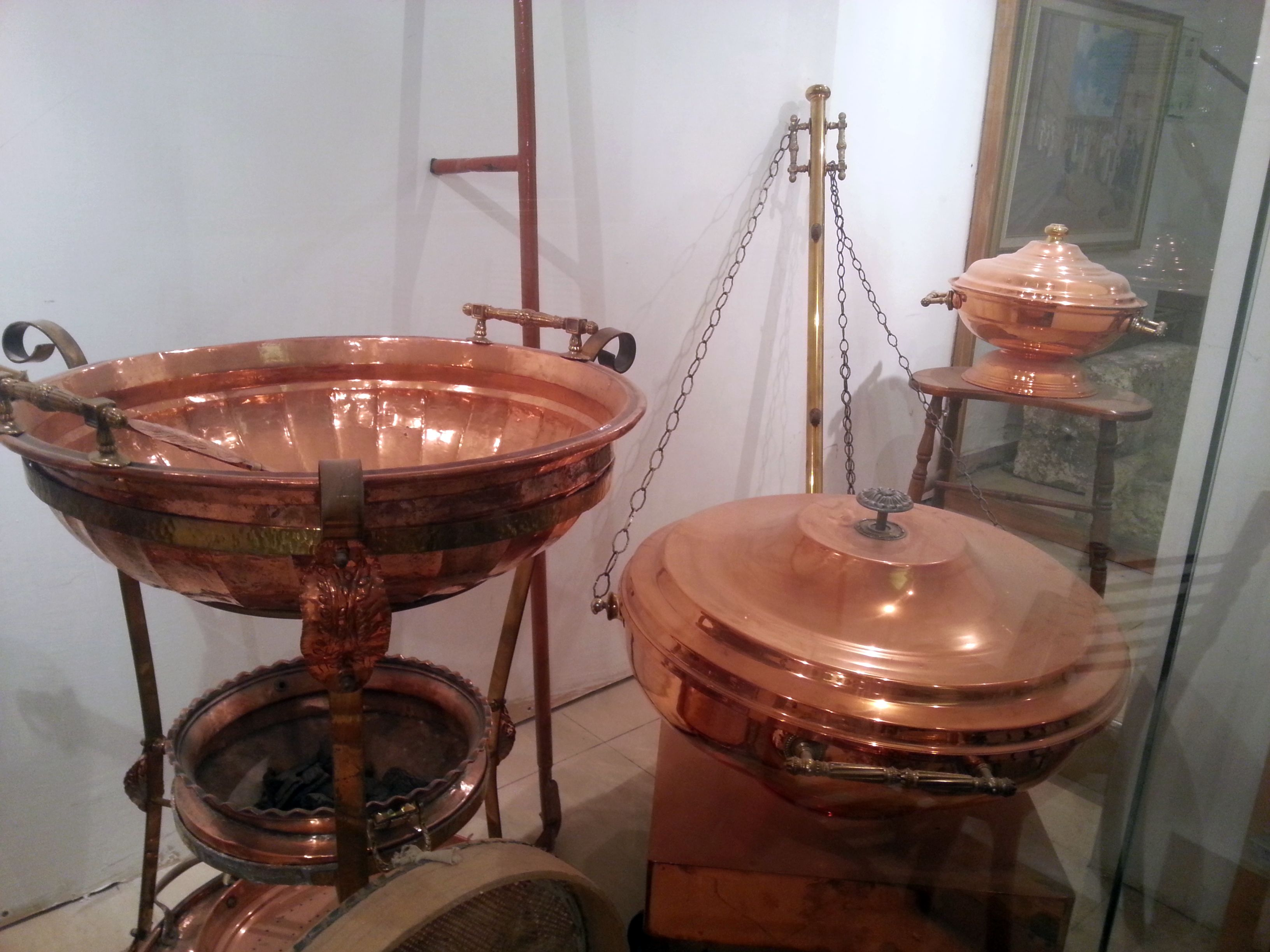 Copper vessels for the Third Temple:  On the left is the Abuv, a three- tiered stand used for roasting the Omer on Passover.  The middle tier contains coal for roasting the barley.  On the far right toward the back is the copper vessel used in preparing the meal offering.