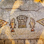 Tabgha on the northwestern shore of the Sea of Galilee, is the traditional site of the multiplication of the loaves and fishes. The above mosaic is found in the Church of the Multiplication in Tabgha.