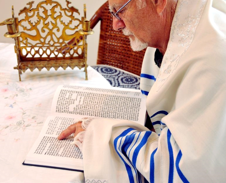 Jewish man-tallit-prayer shawl-Tanakh-Hebrew Scriptures-reading