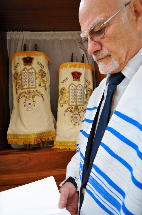 Jewish-Man-Standing-Torah-Scrolls
