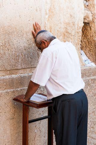 Kippah wearing man-prays-Western Wall