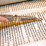 Reading from the Torah scroll with a yad