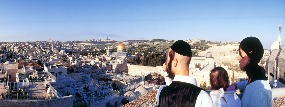 An ultra-Orthodox Jewish family enjoys a panoramic view of Jerusalem.