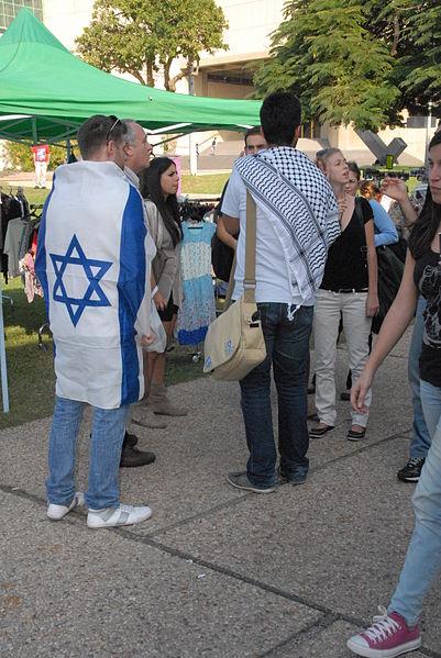 student-Israeli flag-Arabic keffiyeh-Tel Aviv University