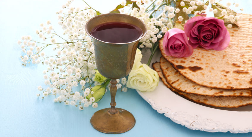 Matzah (unleavened bread) and wine, which is served during the Passover Seder meal.