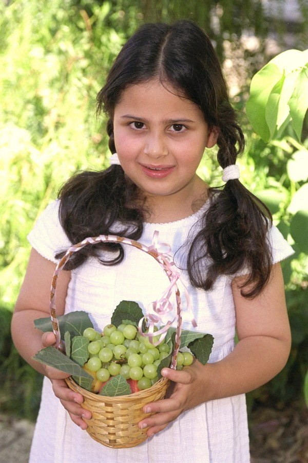 Israeli girl-basket of grapes