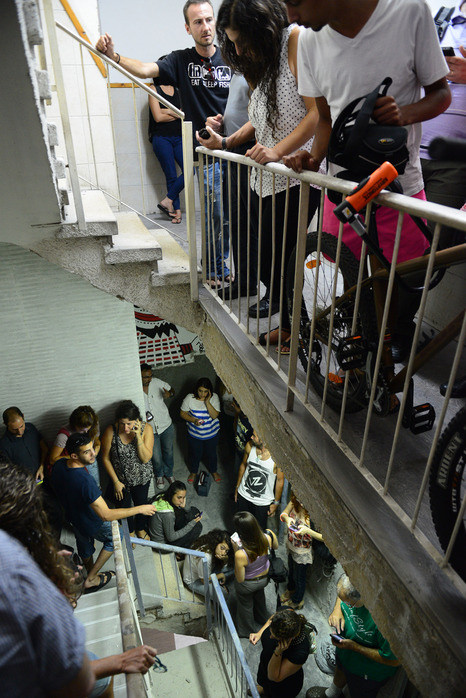 Israelis Take Cover in Stairwell Code Red Siren