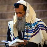 Orthodox Jewish man in prayer-tallit-tefillin