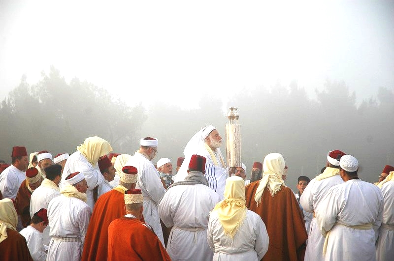 The Samaritans lift the Torah on Pesach (Passover) on Mount Gerizim.