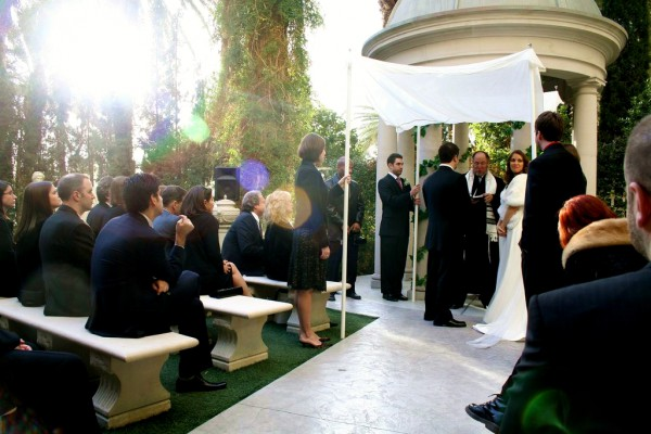 Jewish bride-groom-exchange vows-chuppah