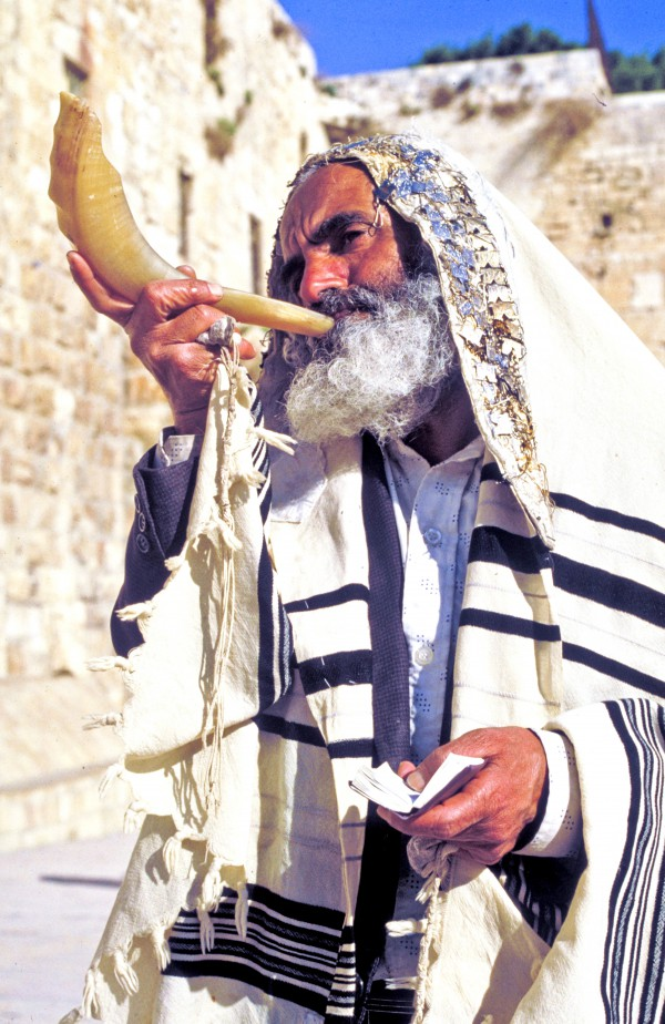 From the second day of Elul to the 28th day, the shofar (ram's horn) is blown after morning services every weekday.  It's distinctive, piercing call is considered a call to repentance.