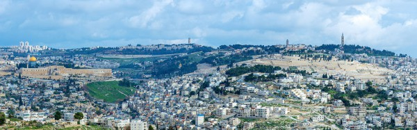 A view of the Mount of Olives, a mountain ridge to the east of the Temple Mount with three peaks running from north to south. The highest, at-Tur, rises to 818 meters. It is named for the olive groves that once covered its slopes.