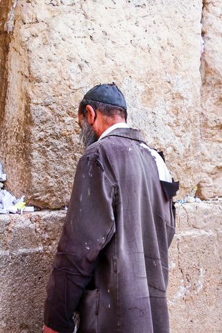 A homeless man in Israel prays at the Western (Wailing) Wall in Jerusalem.