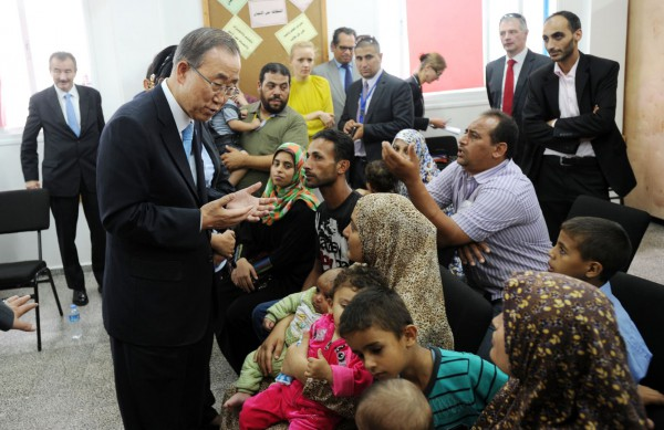 Secretary-General Ban Ki-moon (second from left) meets with internally displaced persons (IDPs) during his visit to the Gaza Strip.