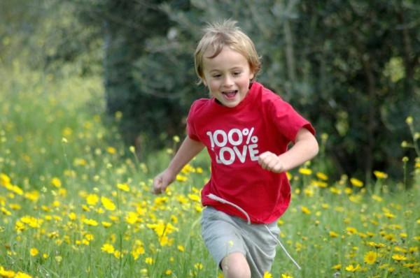 child-runs-meadow