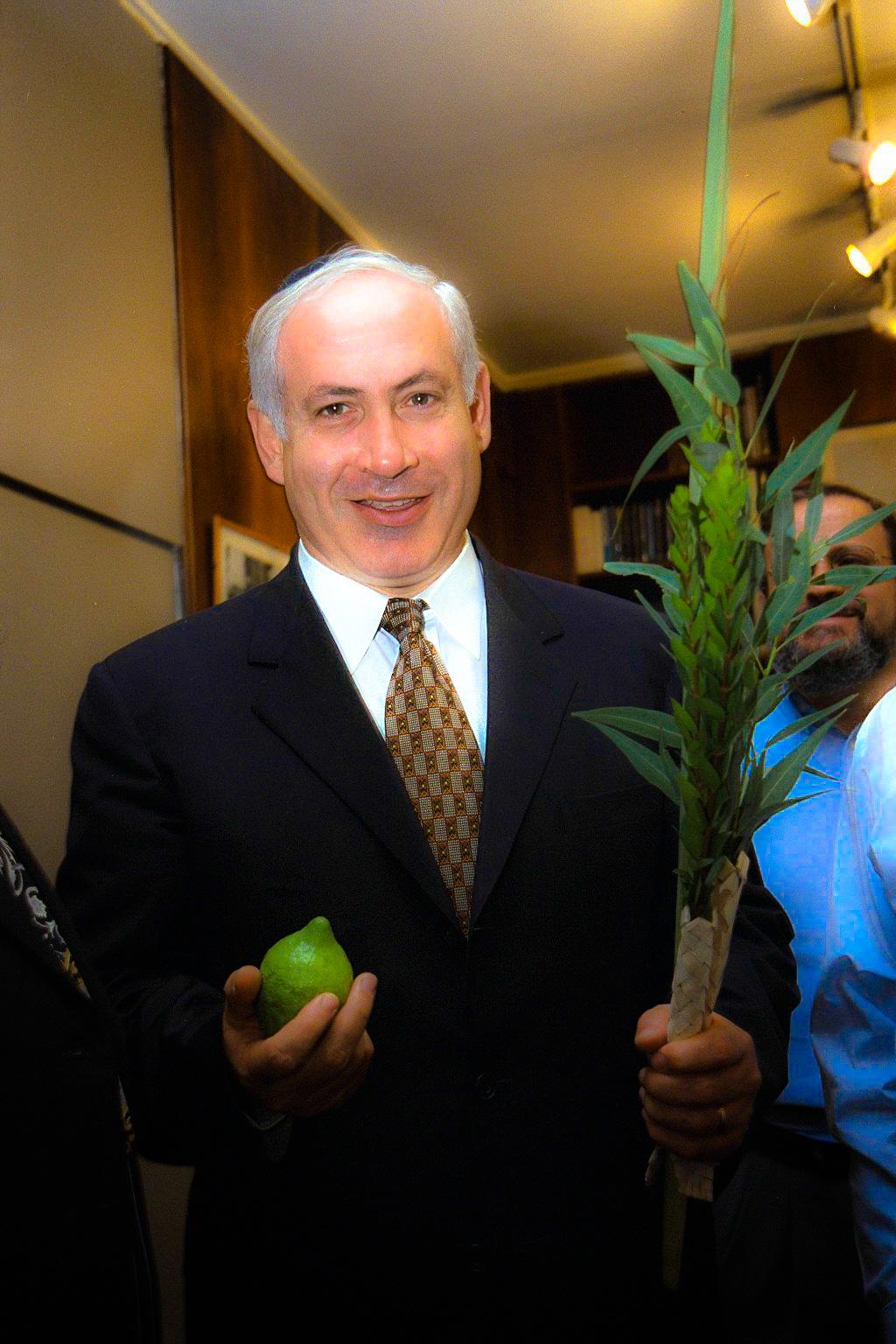 Israeli Prime Minister Benjamin Netanyahu holds the lulav and the etrog (citron) of Sukkot.