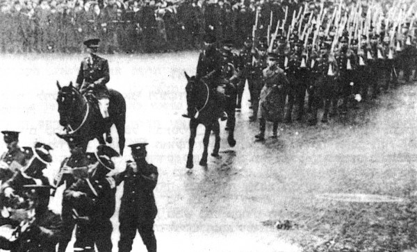 The 38th Royal Fusiliers march on Whitechapel Road in London.
