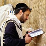 Jewish man prays Western Wailing Wall tefillin phylacteries tallit prayer shawl