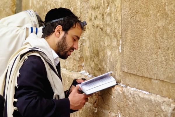 Jewish man-prays-Western Wailing Wall-tefillin-phylacteries-tallit-shawl