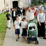 Jewish family walks ancient walls Jerusalem