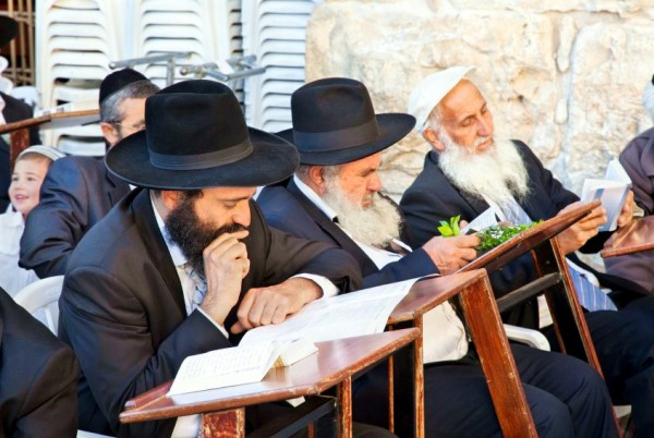 Chasidic Jewish men reading near the Western (Wailing) Wall