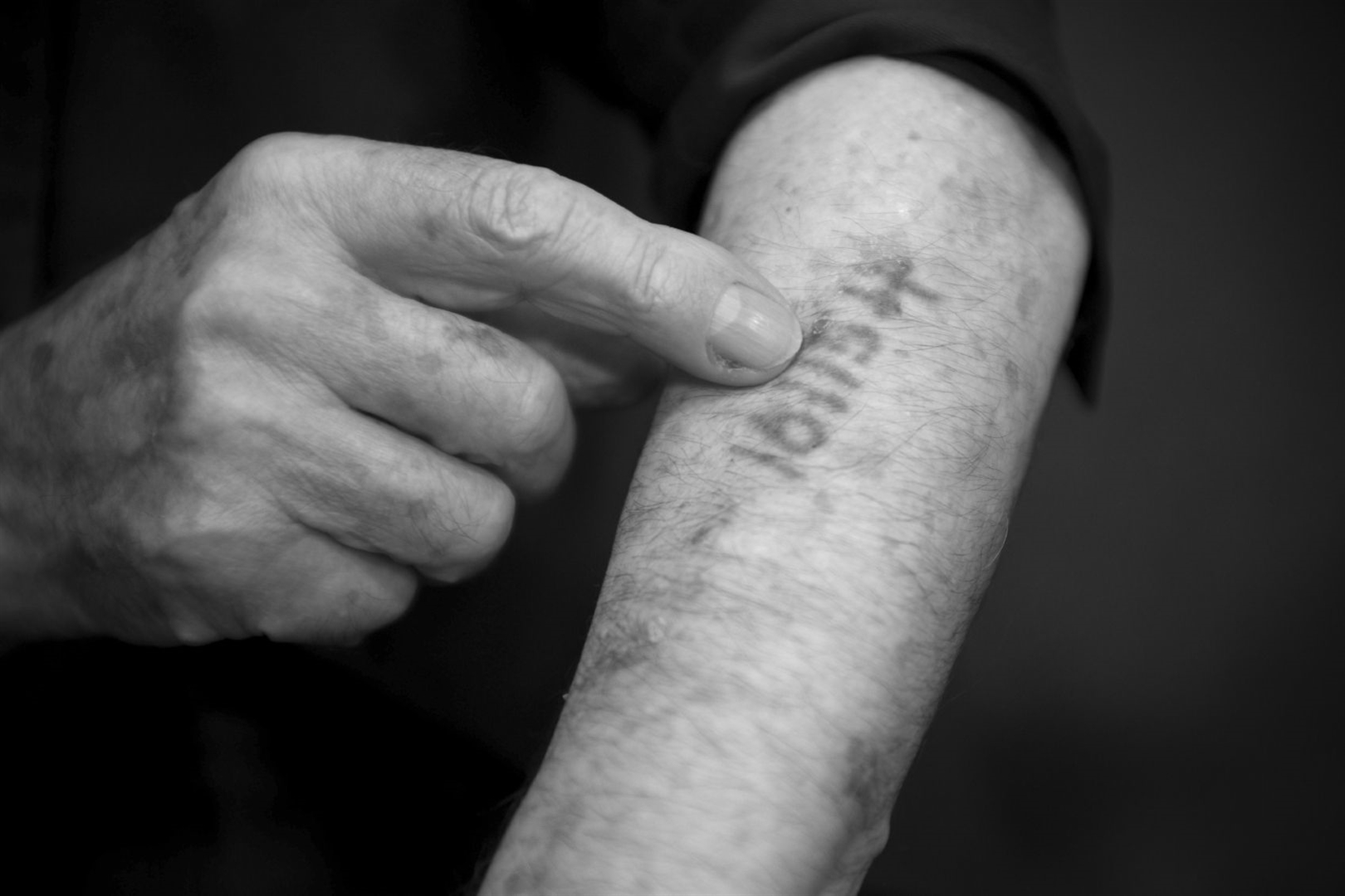 An 80-year-old Holocaust survivor living in Tiberias, Israel, shows the tattoo the Nazis marked him with in a concentration camp during the Holocaust.