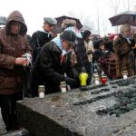 Holocaust survivors light memorial candles at the 63rd anniversary of the liberation of Auschwitz.