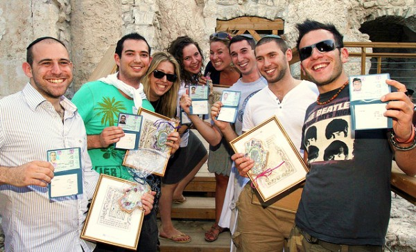 British olim (immigrants) to Israel proudly display their new citizenship papers.