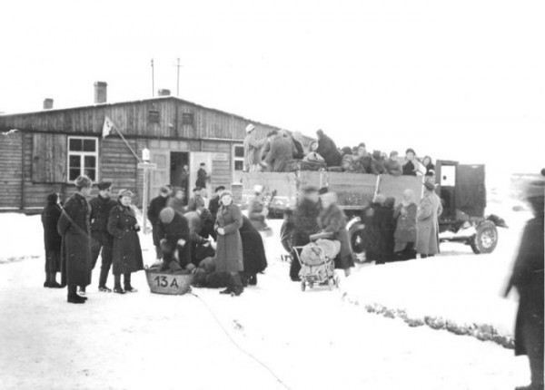 Former prisoners, patients of Soviet field hospital, leave the site of the camp after convalescence.