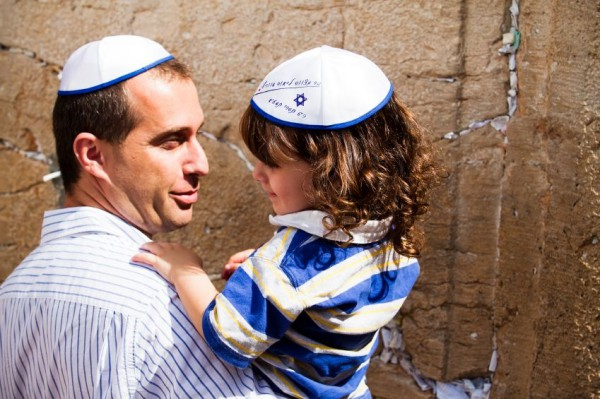 A father and son prepare to pray at the Western (Wailing) Wall.