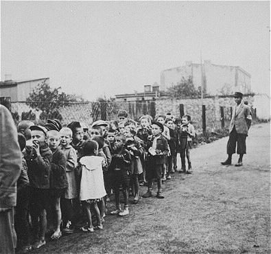 Jewish children in the Lodz Ghetto in German-Occupied Poland are rounded up for extermination in the Chelmno death camp.