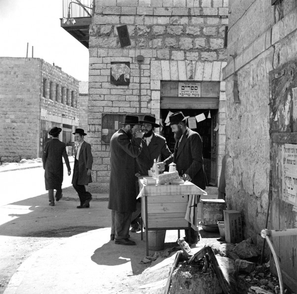 Orthodox Jewish men and street vendor in 1948 Jerusalem