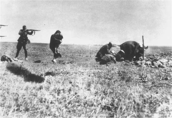 Executions of Jews by German army mobile killing units (Einsatzgruppen) near Ivangorod Ukraine. The above photo was mailed from the Eastern Front to Germany and intercepted at a Warsaw post office by a member of the Polish resistance collecting documentation on Nazi war crimes.