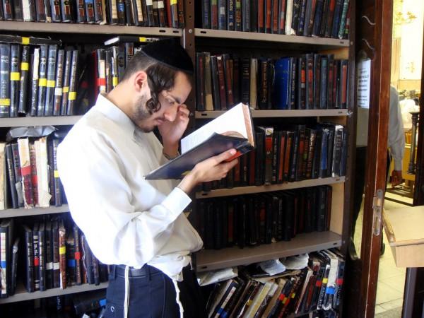 A Jewish man studies at a Yeshiva (Orthodox Jewish seminary) in Jerusalem.
