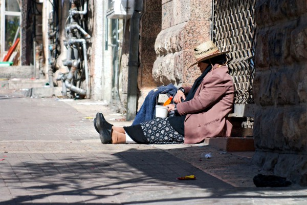 A woman begs in the Jewish Quarter of Jerusalem.