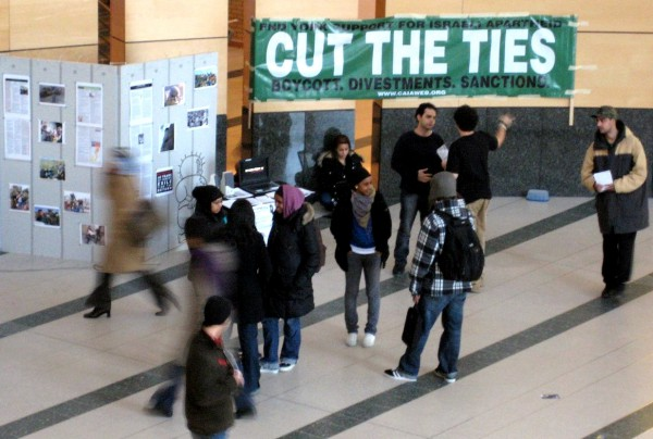 "A banner at Toronto's York University in Toronto tells passersby to end their ""support for Israeli Apartheid: cut the ties: boycott, divestments, sanctions."""