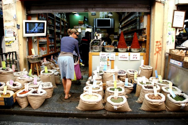 A woman enters a spice store in the Mahane Yehuda Market in Jerusalem.