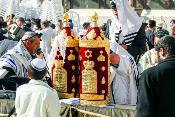 A 13-year-old Jewish boy stands before the Torah scroll during his Bar Mitzvah at the Western (Wailing) Wall in Jerusalem.