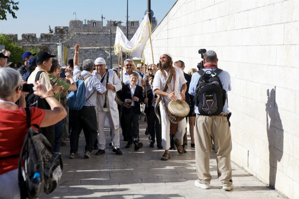 A Bar Mitzvah procession at the Western (Wailing) Wall in Jerusalem, a popular spot to be Bar Mitzvahed for men of all ages.