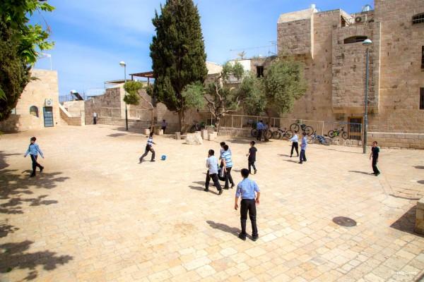 Israeli Jewish children play soccer in Jerusalem