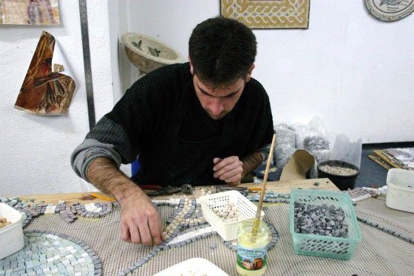 An Israeli artist fashions a mosaic.
